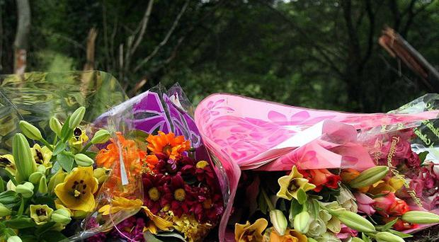 Flowers have been left at the scene of the fatal road crash