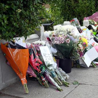 Tributes left outside the house where gun killer Raoul Moat lived in Fenham, Newcastle upon Tyne