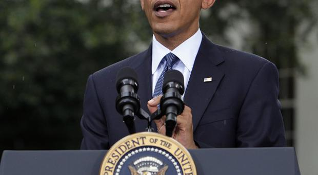 US President Barack Obama addresses the media after a sweeping overhaul of financial regulations won approval (AP)