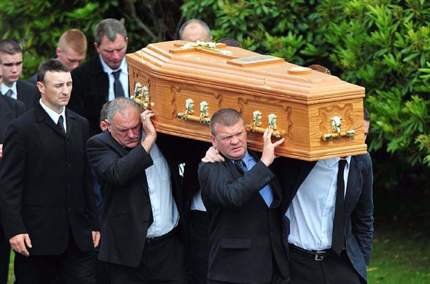 Mourners attend the funeral of Eamonn McDaid at St Mary's Church in Cockhill, Co Donegal
