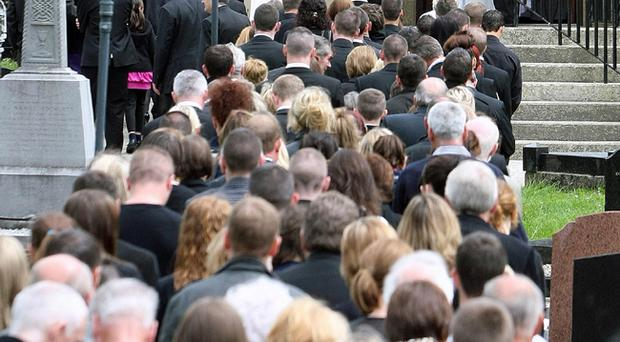 Mourners at the funeral of Ciaran Sweeney at St Mary's Church in Clonmany, Co Donegal