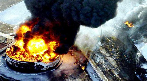 The scene at the Buncefield oil depot following a massive explosion