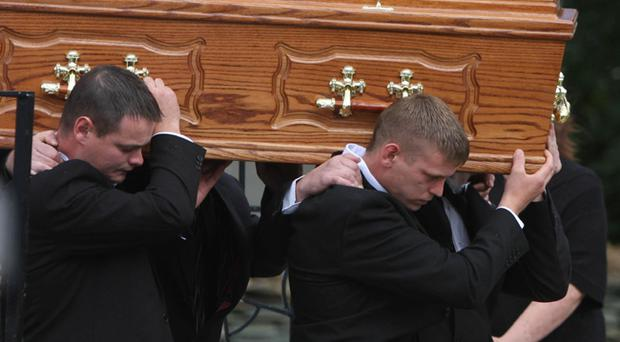 The coffin of James McEleney is carried into St Mary's Church in Clonmany, Co Donegal for his funeral service