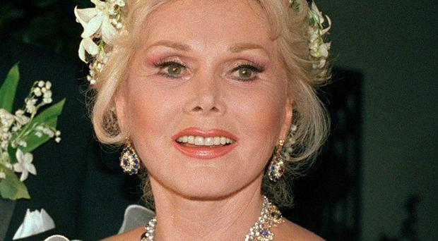 Actress Zsa Zsa Gabor, pictured in August 1986, fell out of bed and broke several bones (AP)