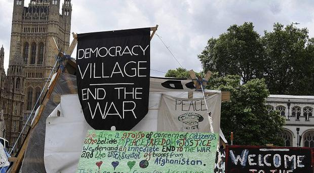 Bailiffs have moved in to evict peace protesters camping in London's Parliament Square Gardens