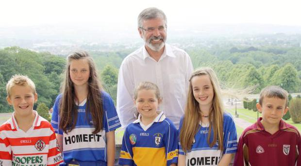Gerry Adams with some young Gaelic games enthusiasts at the Parliament Buildings, Stormont for the launch of Puck on Hill event.