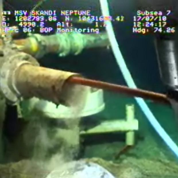 A robotic arm cleans out debris from a pipe at the site of the Deepwater Horizon oil spill in the Gulf of Mexico (AP)