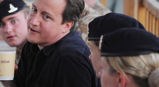 David Cameron said he hoped some British forces could start pulling out of Afghanistan as early as next year