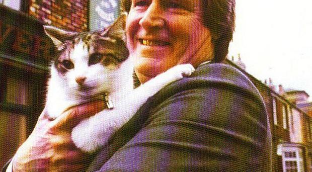 William Roache who plays Ken Barlow in Coronation Street with Frisky the cat
