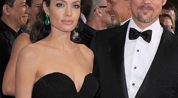 Brad Pitt and Angelina Jolie are expected to settle their privacy claim against the News of the World