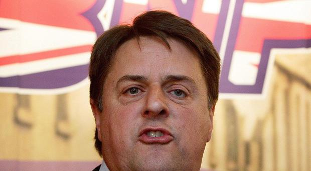 BNP leader Nick Griffin will attend a Buckingham Palace garden party in defiance of left-wing activists