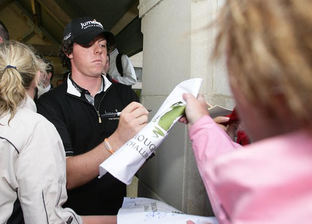 Rory McIlroy signs autographs
