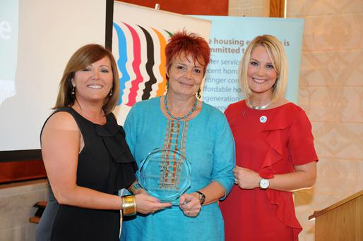 Stephanie Mitchell, of South Belfast Roundtable, receives the award from Jennifer Hawthorne of the Northern Ireland Housing Executive (left) and Sarah Clarke, of UTV