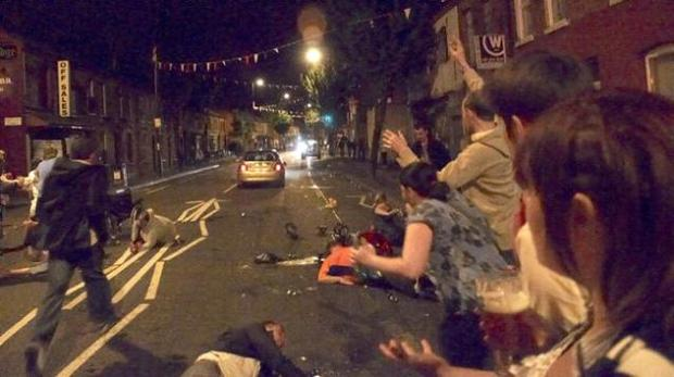 Injured people lie on the road as the car drives off