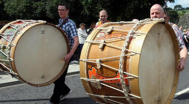 Lambeg drummers march in Glenarm, Co Antrim, during Northern Ireland's Twelth of July parades