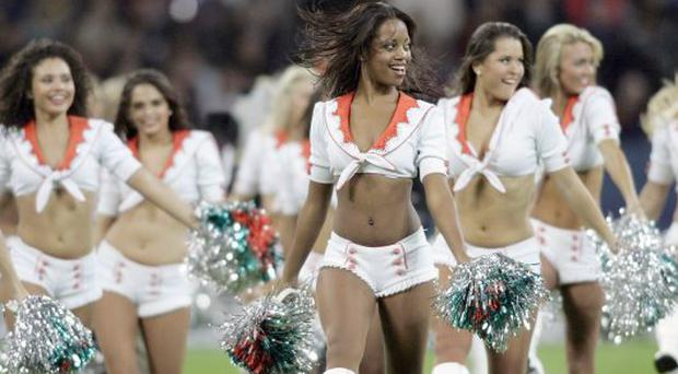 Cheerleaders at the match between Miami Dolphins and New York Giants at Wembley, London.