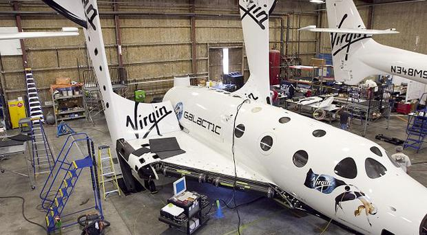 Virgin Galactic's space tourism rocket SpaceShipTwo may fly free in its first glide test later this year (AP)