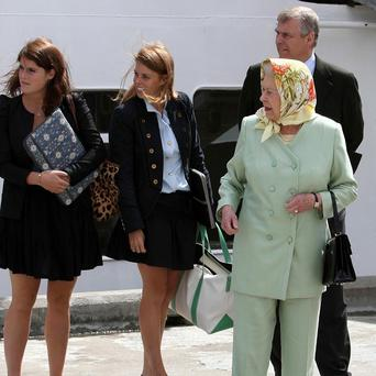 The Queen and the Duke of York with Princess Eugenie (left) and Princess Beatrice