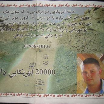 A leaflet shows a missing UN navy sailor believed to have been captured by the Taliban in Afghanistan (AP)