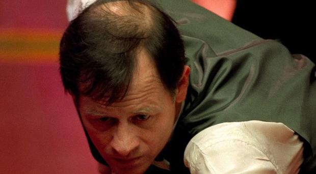 Former world champion Alex Higgins in action in 1994