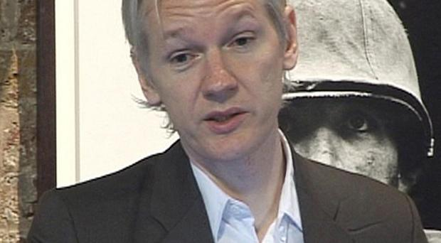 WikiLeaks founder Julian Assange answers questions following the leak of tens of thousands of secret files about the war in Afghanistan
