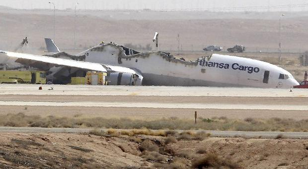A Lufthansa cargo plane caught fire and split in half as it was landing in Riyadh (AP)