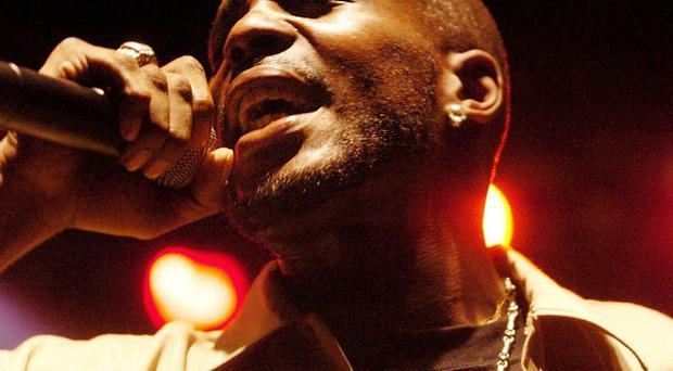 Rapper DMX has turned himself in at a courthouse to begin a 90-day jail sentence