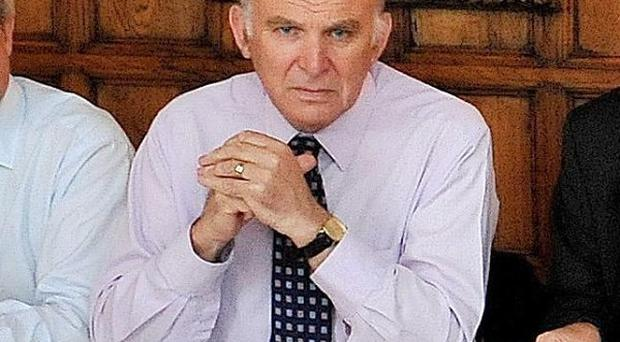 Vince Cable said there was no rift in the cabinet over immigration policy as he and David Cameron visited India