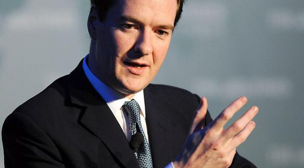 Chancellor George Osborne will review measures to rebalance the Northern Ireland economy and make it less dependant on the public sector