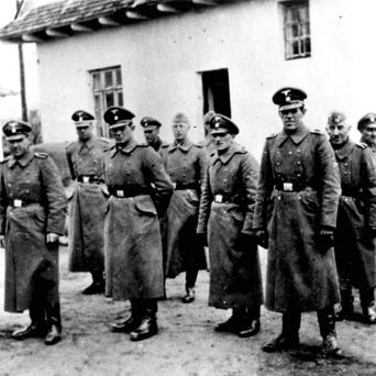 Nazi guards at Belzec death camp in occupied Poland in 1942 (AP)