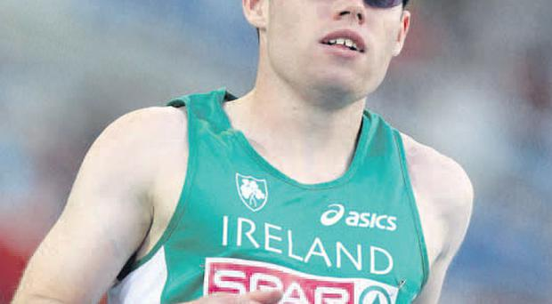 Jason Smyth completes his heat and qualifies for the semis