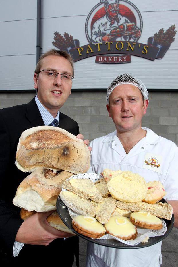 Paul McClurg, Bank of Ireland and Warren Patton, Pattons Bakery at the official opening of Pattons Bakery's new premises in Newtownards