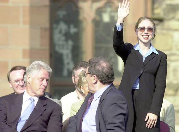 Official role: Her father and John Hume look on as Chelsea waves to the crowdin the Guildhall , Londonderry, during Clinton'sreturn visit in 2001