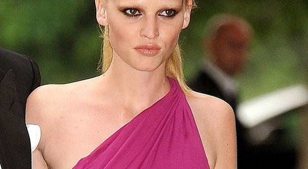 Lara Stone is taking legal action over pictures which appeared in French Playboy