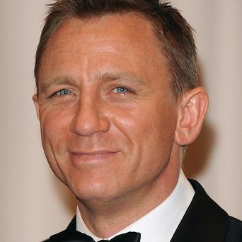 Daniel Craig has signed up to star in a remake of The Girl With The Dragon Tattoo