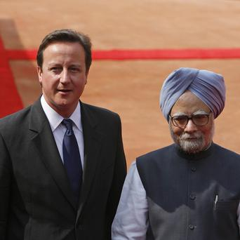 David Cameron and Indian PM Manmohan Singh attended a ceremonial reception (AP)