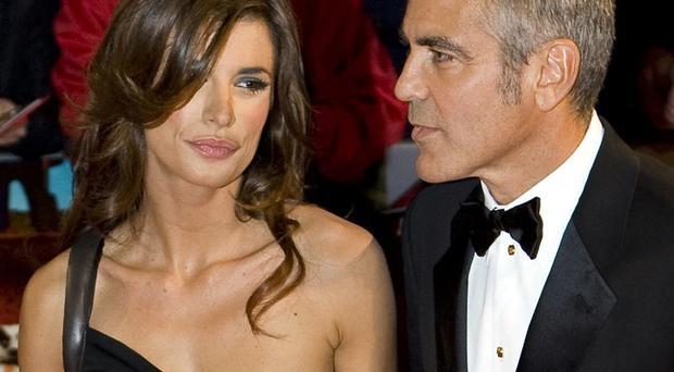 Claims: George Clooney with Elisabetta Canalis