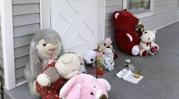 Stuffed toys are placed as tributes to Aunesti Lee Allen, 3, who was killed in Indianapolis. (AP)