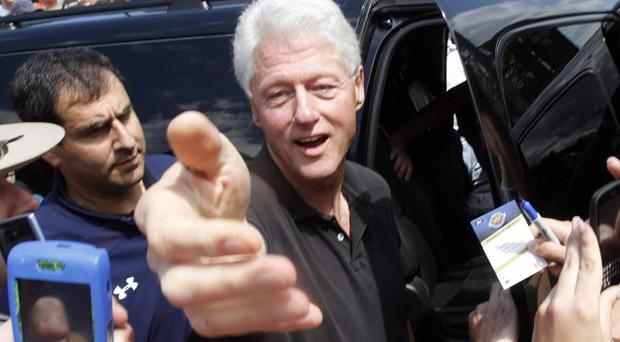 Former president Bill Clinton greets well wishers in Rhinebeck, New York (AP)