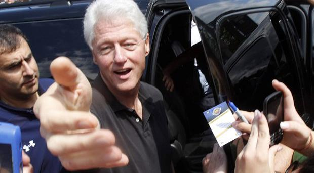 Former president Bill Clinton greets well wishers in Rhinebeck, New York