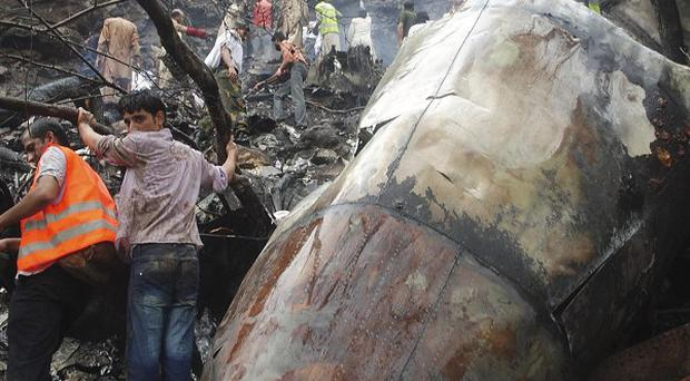The black box from the plane that crashed in Pakistan has been located by emergency workers