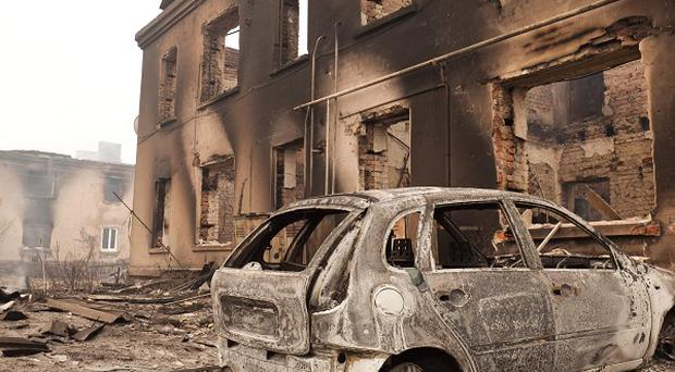 A charred car stands in the village of Mokhovoe destroyed by a forest fire near the town of Lukhovitsy