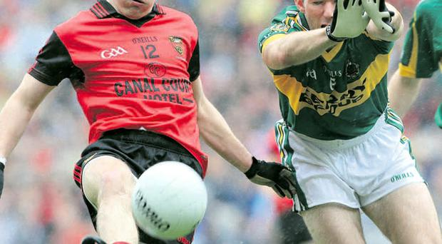 On the attack: Down's Paul McComiskey avoids a block from Kerry's Mike McCarthy