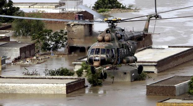 A Pakistan army helicopter evacuates stranded villagers in Nowshera
