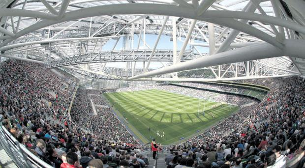 Stadium of light: Fans inside the new Aviva stadium in Dublin watch the Ulster/Leinster versus Connacht/Munster game marking the opening of the ground