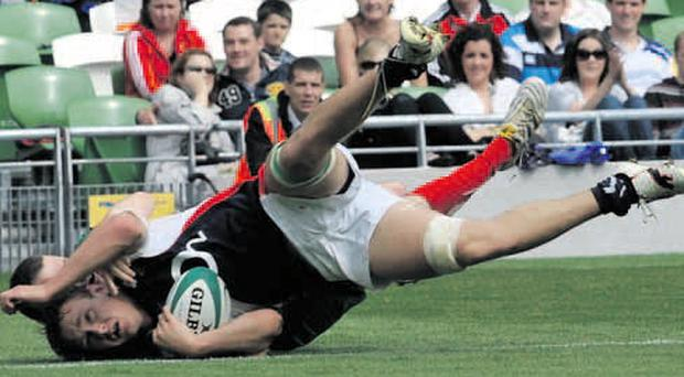Touchdown: Ulster man Craig Gilroy nails the first try at the new Aviva Stadium on Saturday