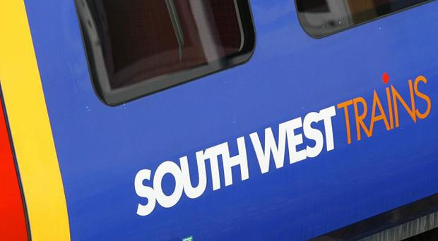 Union leaders accused South West Trains of effectively banning staff from volunteering for the 2012 Olympics
