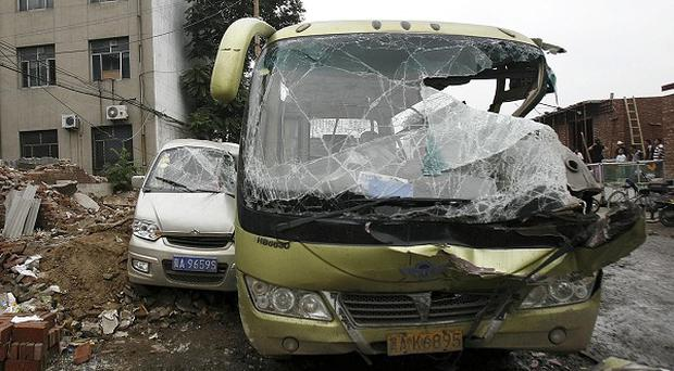 Smashed vehicles after a drunken tractor driver went on a rampage in northern China