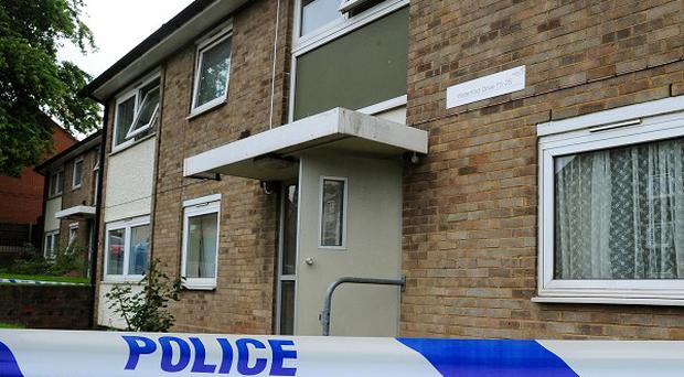 The deaths of two men found in separate flats in the same block are linked and both were murdered