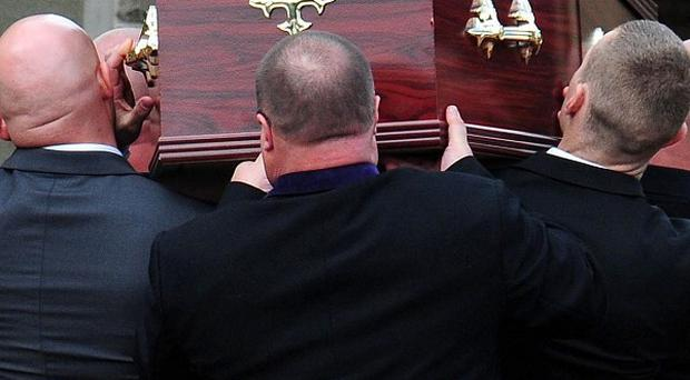 The coffin of Raoul Moat is carried into West Road Crematorium in Newcastle, during a private ceremony